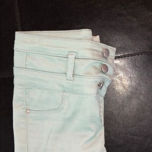 Green high waisted skinny jeans
